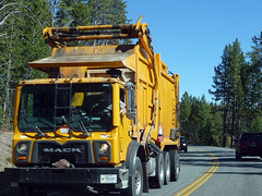 Yellow Garbage Truck (Photo Nut 2011) Tags: yellow trash truck nationalpark garbage junk wyoming refuse mack sanitation garbagetruck trashtruck wastedisposal