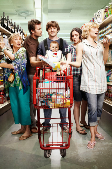 The five white adults--two men and three women--on Raising Hope at the grocery store, surrounding a shopping cart with a baby sitting inside