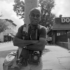 (patrickjoust) Tags: street camera city portrait people urban usa man west 120 6x6 tlr blancoynegro film home festival analog america pose square lens person us reflex md focus fuji photographer mechanical pennsylvania united north patrick twin maryland super baltimore cadillac parade 150 v homecoming cameras epson fujifilm medium format neopan 100 states manual 500 rodinal 80 joust developed ricoh develop acros estados 80mm f35 blancetnoir unidos ricohflex v500 schwarzundweiss autaut patrickjoust