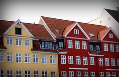 yellow or red (JorunnSjofn) Tags: houses windows red vacation holiday yellow canon copenhagen nyhavn colorful roofs picnik 50mm18 atumn 2011 jorunn