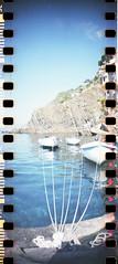 img012 (Oevaluna) Tags: sun film 35mm see lomo mare liguria barche cielo terre rocket sole viaggio cinque riomaggiore sprocket pellicola