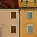 Pastel colored houses at Tartini's square in Piran