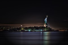 The Statue of Liberty (mudpig) Tags: nyc newyorkcity longexposure light cloud ny newyork reflection statue brooklyn night liberty newjersey nikon jerseycity flag nj americanflag hudsonriver gothamist statueofliberty hdr d300 newyorkharbor mudpig stevekelley stevenkelley
