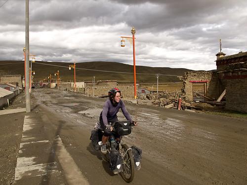 Emma cycling through muddy town