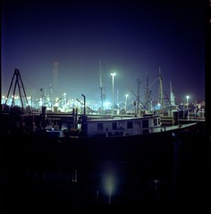Pilgrim Monument, fishing boats, at night, Provincetown (joe.(atruestory)) Tags: ocean travel light sea summer vacation seascape color 6x6 film beach church water architecture night mediumformat square spring iso400 newengland kodakportra400vc 120film bronica squareformat ptown portra 400asa asa400 portra400vc zenza bronicas2a s2a 75mmf28 provincetownmassachusetts zenzabronicas2a epsonv500 epsonperfectionv500 perfectionv500 believeinfilm scan1009220011