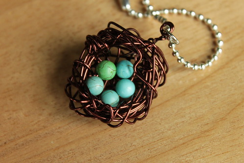 brown nest with five aqua howlite beads
