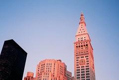 pink city sundown (ho_hokus) Tags: nyc newyorkcity pink sunset newyork clock film analog sundown manhattan 35mmfilm analogue olympustrip35 olympustrip metropolitanlifetower fujisuperia100
