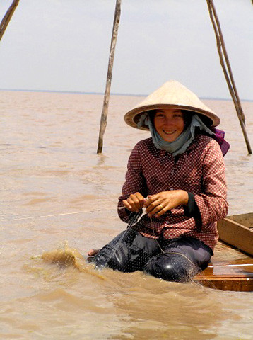 Net-mending on the Mekong River, Vietnam. Photo by Eric Baran, 2005.