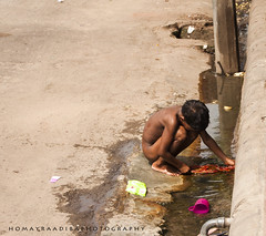 a little street child washing his dress in the water of a drain ! (Homayra Adiba (HOMON)) Tags: street boy portrait photography little candid poor documentary lifestyle dhaka bangladesh motijheel