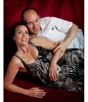 Romantic couple pose for boudoir glamour photography to celebrate one of their birthdays.