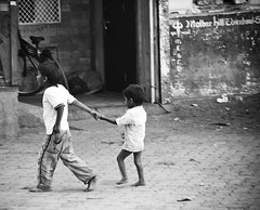 Follow me (Michael Godek) Tags: world travel people blackandwhite bw india love children friendship poor young siblings relationship bombay barefoot leader holdinghands mumbai constant michaelgodek