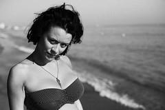 girl in autumn sun (gorbot.) Tags: autumn sea blackandwhite bw beach girl f14 roberta marbella canoneos5d nikonfmount planar5014zf silverefex carlzeisszf50mmplanarf14 eosadaptor
