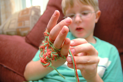 day 2625: wherein odin attempts to teach me advanced finger knitting.