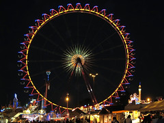 Ferris Wheel at Night (Batikart) Tags: city carnival blue autumn light red sky urban black color colour rot art fall wheel yellow festival fairytale night canon germany circle geotagged fun deutschland evening licht amusement colorful europa europe cityscape basket ride nightshot stuttga