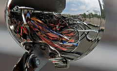 Self-portrait with lots of Dutch Bicycles (hogsvilleBrit) Tags: urban distortion selfportrait abstract holland reflection amsterdam bicycle metal 6ws sixwordstory bikes chrome fiets cycles