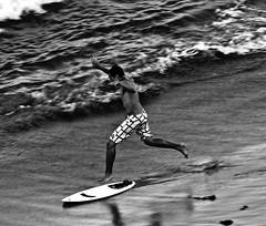 dude (nikkidelmont) Tags: bw beach movement nikon carlton action surfer ritz skinboard nikkidelmont floridarboy