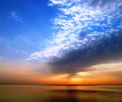 he who dares wins (nuframe) Tags: africa morning blue sea sky orange seascape storm colour water ahead silhouette clouds sunrise early skies glow bright tunisia threatening gorgeous horizon north formation glorious glowing rays through sousse beams sunbeams peeping 2011 nuframe
