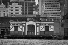 Pier 31 and a city shoreline (Chris D 2006) Tags: sanfrancisco ca blackandwhite bw transamericapyramid pier31 geocity camera:make=canon exif:make=canon exif:iso_speed=100 exif:focal_length=400mm camera:model=canoneos5dmarkii geostate geocountrys exif:model=canoneos5dmarkii exif:lens=ef100400mmf4556lisusm exif:aperture=63