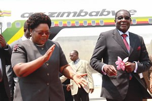 Republic of Zimbabwe Vice-President Joice Mujuru welcoming President Robert Mugabe to Harare International Airport on October 2, 2011. Mugabe had been in Singapore.