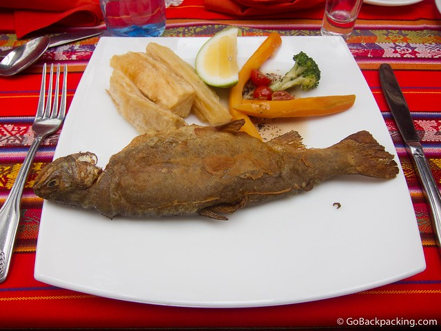Fried trucha (trout) with yuca and vegetables.