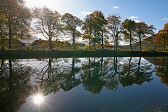 Time To Reflect (RoystonVasey) Tags: autumn sunlight reflection tree canon eos scotland canal zoom fort sigma william sparkle sunburst caledonian lochaber corpach banavie caol 1770mm 400d