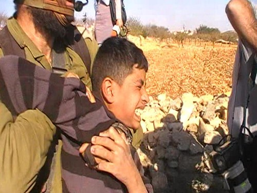 From flickr.com: Child Strangled By Israeli Soldier {MID-201397}