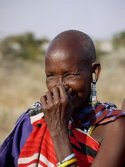 Maasai Woman #1 (Jo Pye) Tags: africa travel portrait woman travelling smile face smiling tanzania happy lumix beads robe african stripes traditional ears tribal ear laugh bead g1 jewelery tradition tribe stretched shavedhead maasai beaded robes tanzanian 2011 jopye