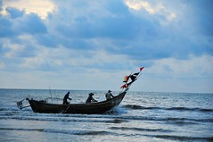 Fishboat  (MelindaChan ^..^) Tags: china sea man water boat fisherman flag mel melinda fishboat wuchuan chanmelmel  melindachan