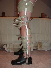 Side View of Braces with Shin Restraints Buckled in Place (KAFOmaker) Tags: leather legs braces leg bondage strap cuff tight shins bound brace straps cuffs stiff bracing restraint restrain rigid braced strapping legbrace legbraces restraned legbracing heavystrappedwithshincuffs