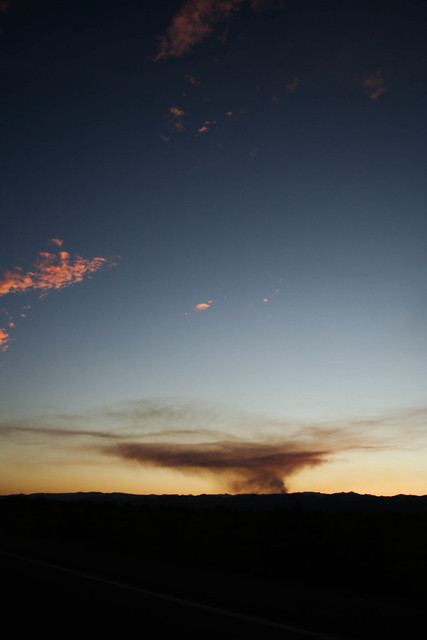 The sun sets on fires north of Vegas