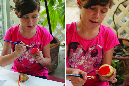 applying paint to potato stamp for Rosh Hashanah craft