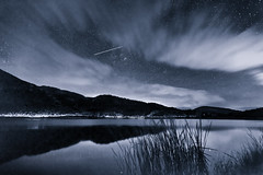 Passing by (ChrisBrn) Tags: lake night clouds reflections airplane stars trails stormynight airplanetrails starreflections