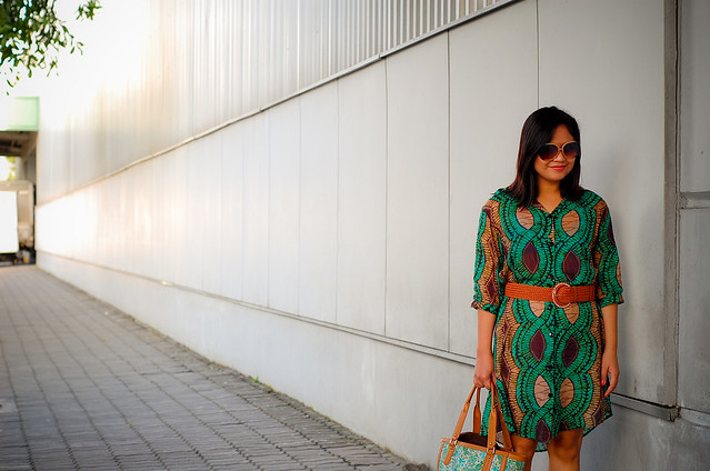 green dress, green bag, nude wedege booties