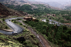 Hermit's Hideaway (Hands of Skill) Tags: road street travel trees house mountain mountains streets tree green water car rock stone turn canon way eos rocks stones hill hills yemen turns shrubs afterrain d550 mountainous