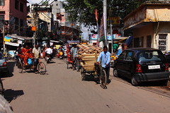0130 Chawri Bazaar - Old Delhi, India (Traveling Man  Traveling, back soon) Tags: woman india man canon market delhi indian scooter bazaar rickshaw laborer sari bazar wholesale subcontinent old 50d canonef24105mmf4lisusm bazaar canoneos50d chawri bazar delhi markaveritt chawri