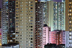 apartment building at night (leungchopan) Tags: life china new city red sea sky urban house building tower home window water vertical wall architecture modern night floors skyscraper real hongkong town high construction exterior estate apartment sunny structure hong kong flats fancy highrise infrastructure housing blinds curtains block tall rise residence residential development multistory mortgage realty gettyimageshongkongmacauq2 gettyimageshongkongmacauq3
