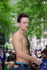 Day 9 Occupy Wall Street September 25 2011 Shankbone 32 (david_shankbone) Tags: trees boy shirtless hairy signs newyork man sexy guy green youth outside photography movement underw