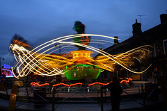 Bouncing Frog Ride (indianewman) Tags: sky motion blur lines night children person lights town gates fair frog motionblur rides lighttrails funfair bounce bouncing chippingsodbury mopfair