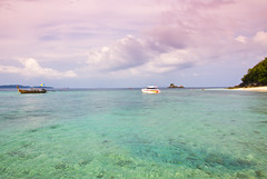 Colors of Thailand (Jim Boud) Tags: ocean travel pink vacation seascape water clouds landscape thailand islands boat asia southeastasia paradise tour speedboat turquoise pastel relaxing vivid wideangle thai woodenboat phuket pinksky efs lightroom artisticphotography superwideangle asiapacific shallowwater phuketisland khainok jimboud khainokisland canoneos60d jamesboud canonefs1585mmf3556isusm canon1585mm