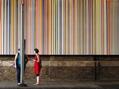 Stripes (preynolds) Tags: people london stripes streetphotography busstop reddress twowomen