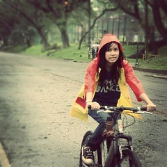 Biking in the rain (limajalo) Tags: trees up rain bike square converse squareformat biking diliman raincoat oval iphoneography instagramapp uploaded:by=instagram