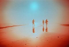 Glowing (fotobes) Tags: pink sea people orange mist film beach water misty fog 35mm sussex solar lca xpro crossprocessed sand waves glow colours crossprocess candid tide foggy surreal radiation atmosphere crossprocessing radioactive glowing lowtide analogue brightonbeach figures murky dreamscape fujivelvia100 brighon fotobes