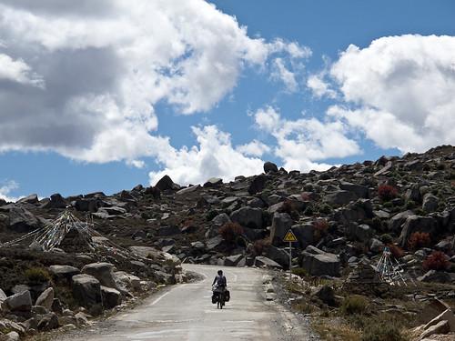 Emma cycling through boulder strewn plateau