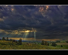 light therapy (Wim Koopman) Tags: road trees light sky mill weather clouds canon germany landscape deutschland photography countryside photo horizon hill stock powershot pole divine electricity rays heavy duitsland lightrays stockphoto s90 stockphotography s100 wpk s95