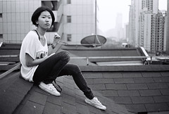 Joey (Woods | Damien) Tags: china camera roof portrait blackandwhite film girl asian pretty shanghai noiretblanc chinese rangefinder   rue kodaktmax400 argentique olympus35sp jingandistrict  shanghaiflickrmeetup