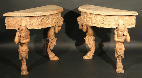 A pair of Italian 18th century walnut tables in the baroque style