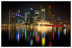 City lights pt.10 (Tuomas A. Lehtinen Photography) Tags: city travel urban reflection architecture modern night digital skyscraper marina canon river dark eos rebel lights evening bay lowlight singapore asia cityscape niceshot angle dusk south wide sigma center east cbd 1020mm xti 400d platinumheartaward earthasia doubleniceshot tripleniceshot mygearandme mygearandmepremium mygearandmebronze mygearandmesilver mygearandmegold mygearandmeplatinum mygearandmediamond artistoftheyearlevel3 artistoftheyearlevel4 artistoftheyearlevel5