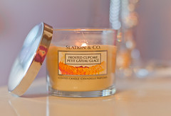 frosted cupcake candle (Shandi-lee) Tags: orange yellow canon silver fire 50mm soft candle purple bokeh pastel 14 warmth naturallight burning flame cupcake 7d lit tones creamy burningcandle bathbodyworks scentedcandle litcandle frostedcupcake shandilee