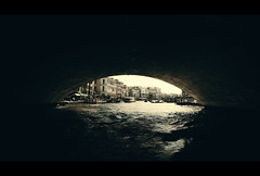 Leaving the Darkness (Ricky Phoolka) Tags: city bridge venice windows light people color reflection building water architecture canon buildings reflections canal europe cityscape shadows traffic pov widescreen nostalgic gondola venetian directorofphotography cinematographer cinematic vanishing grandcanal waterway watertaxi prespective towncenter vantagepoint provoking vibran phoolka canon5dmarkii evokingemotionphotographybyrickyphoolka photographricky