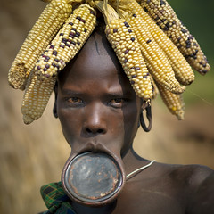 Mursi woman with lip plate - Omo Ethiopia (Eric Lafforgue) Tags: woman hat corn artistic culture tribal mais ornament tribes lip bodypainting tradition tribe ethnic rite tribo headdress adornment pigments headwear ethnology headgear tribu eastafrica thiopien etiopia ethiopie etiopa 3314  etiopija ethnie ethiopi  etiopien etipia  etiyopya  nomadicpeople         peoplesoftheomovalley